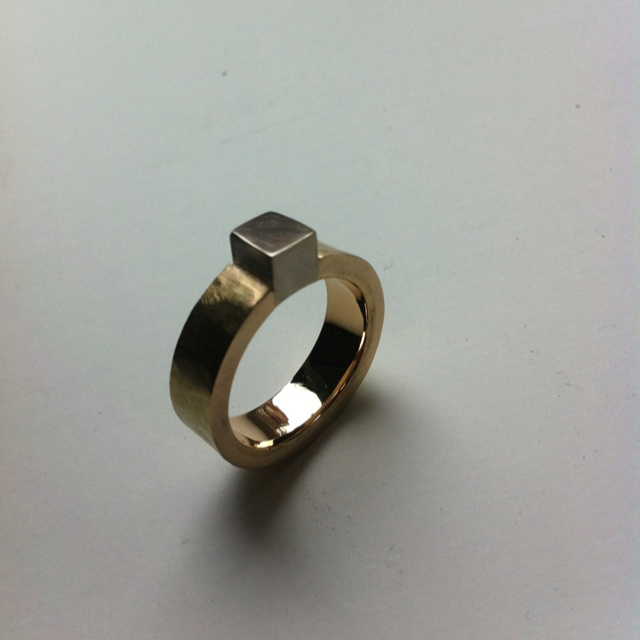 Raw golden ring in red and white gold. Made out of five old wedding rings - now it will be a new wedding ring for a lovely lady.