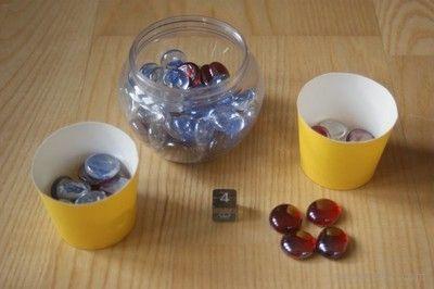 Matematyczna gra dla przedszkolaków. Kto pierwszy zapełni pojemniczek, ten wygrywa!