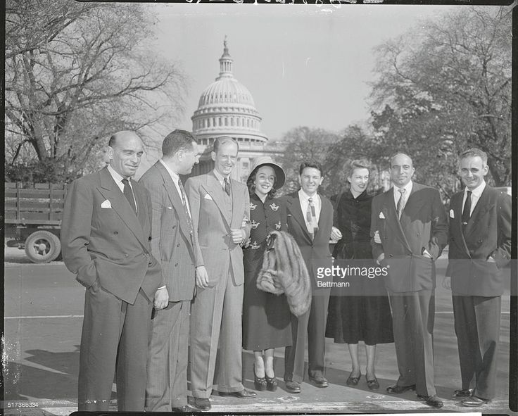 There can't be many celebrities left in Hollywood with all the 'Greats' and 'Near Greats' who are in DC for the congressional probe into communist activities in the movie industry. Here are a few of the prominent film figures who attended the session as they left the House Office Building. Left to right: Paul Stewart, writer-director; Phillips Epstein, writer; Uta Hagen, actress; John Garfield, Actor; Bernice Parks, actress; Paul Draper, dancer; Oscar Serlin, producer, and Julius Epstein…
