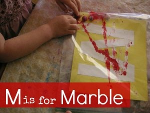 Mess free marble painting for the Letter M...you could also do this with just a piece of paper