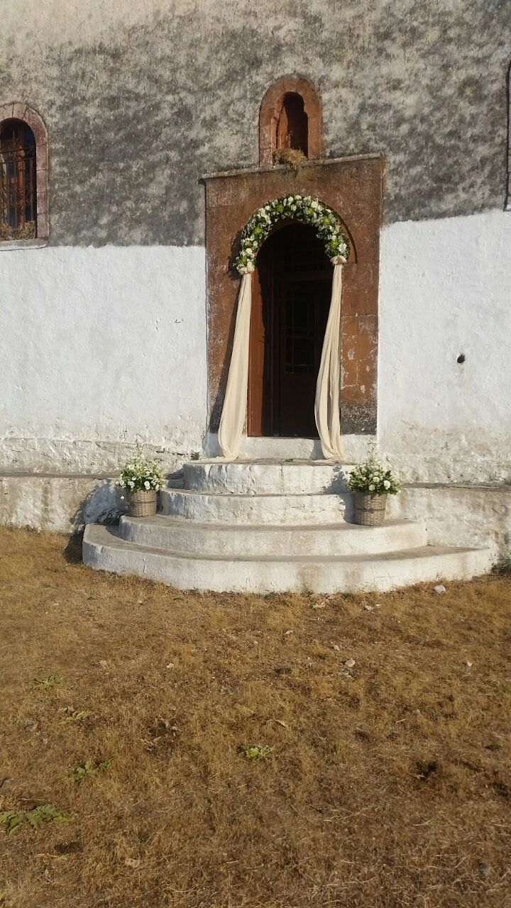 Wildflower white and green, wedding church decoration for wedding at stone church in Plagia Greece by Gourioti Flowers