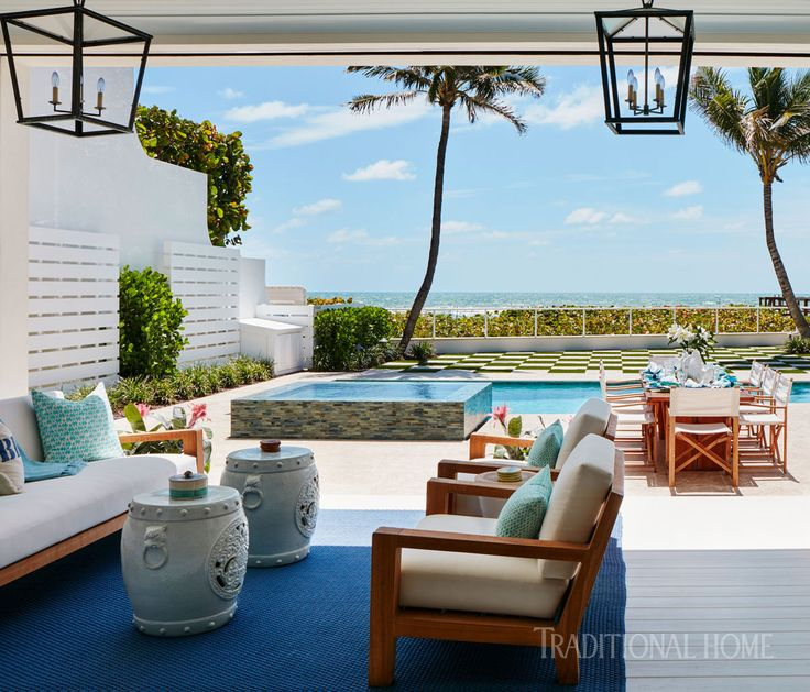 Anchored by a Dash & Albert rug, the loggia serves as the outdoor living room. - Photo: Carmel Brantley / Design: Lisa Peterson and Melanie Hayes