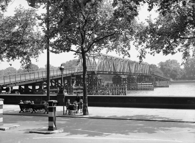 his temporary bridge at Battersea, June 11, 1945, was one of three constructed over the Thames in London, capable of carrying tanks, guns, and heavy motor traffic if the permanent bridges were bombed. When the Hungerford Bridge at Westminster was hit by a buzz bomb in 1944 the substitute was opened for pedestrian traffic.