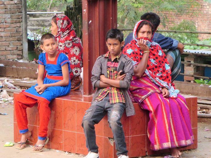 Passengers awaiting a local train on a platform between Rajshahi and Khulna, Bangladesh.