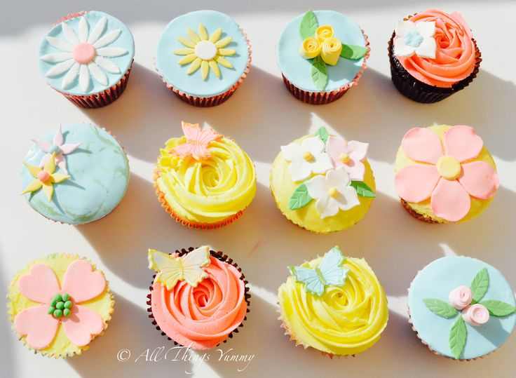 Mother's Day Cupcake Garden is a set of 12 cupcakes, each customized individually to emulate a real flower, surrounded by butterflies. #mothersday