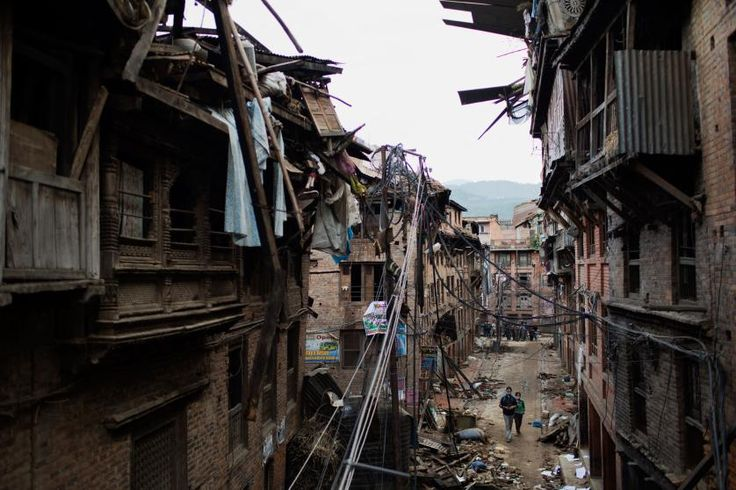 People walk through the damaged streets in the ancient city of Bhaktapur, Kathmandu Valley, April 29, 2015.