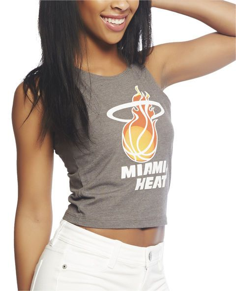"""Add some flair to your game day outfit and look totally hot in this tank! It features a heathered knit body with a Miami Heat™ logo screen printed along the front, scoop neck, and a cropped construction.  Model is 5'9"""" and wears a size small   47% Cotton / 48% Polyester / 5% Spandex Machine Wash Imported"""