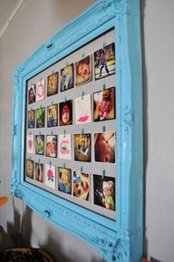clothesline frame, makes it very easy to change out the pictures-Cute idea instead of photos in one frame.