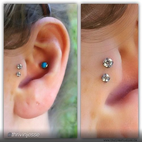 Double Tragus piercing by Jesse Villemarie of Thrive Studios. Jewelry by Neo Metal.