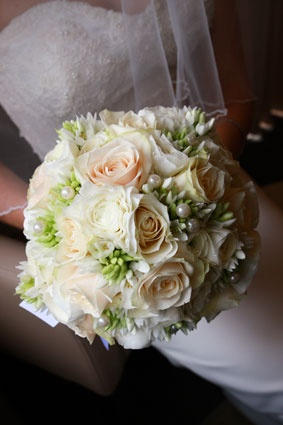 Compact posy of chantilly roses, chincherinchee & pearls
