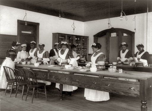 Ten women in a cooking class at the Hampton Institute in Hampton, Va. Photograph by Frances Benjamin Johnston, c. 1899