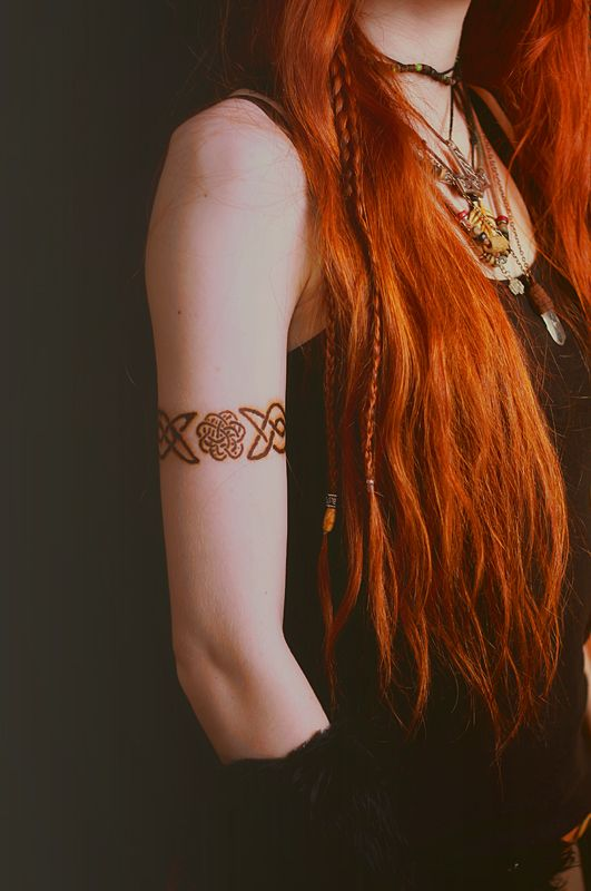 Dragon's cannot have red hair in my story world, but the tattoos are an idea. . .
