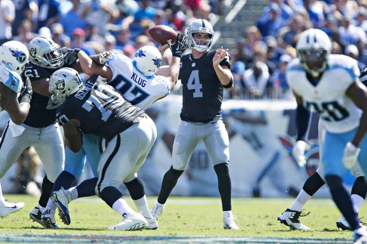 David Carr #4 of the Oakland Raiders throws a pass under pressure from Karl Klug #97 of the Tennessee Titans at Nissan Stadium on September 25, 2016 in Nashville, Tennessee.  (Photo by Wesley Hitt/Getty Images)