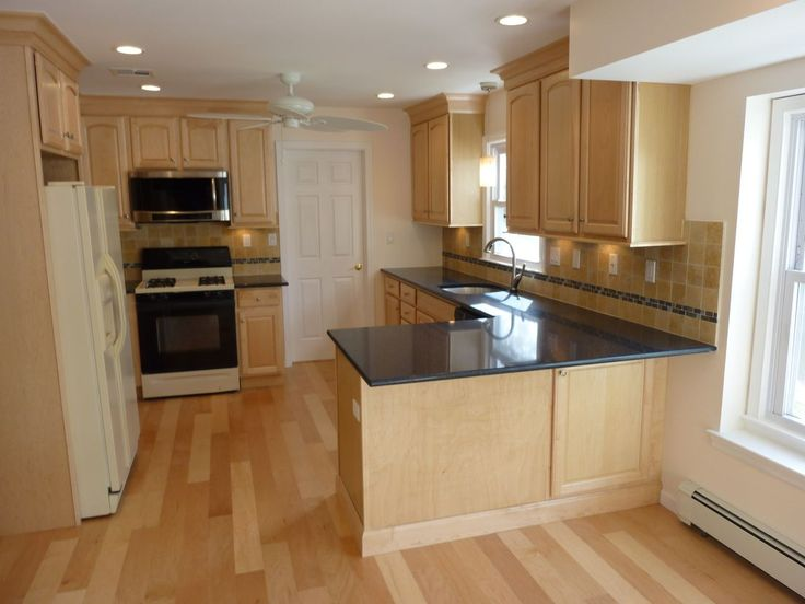 Modern Kitchen, Dark Counter Tops, Peninsula Seating, Wood Floors
