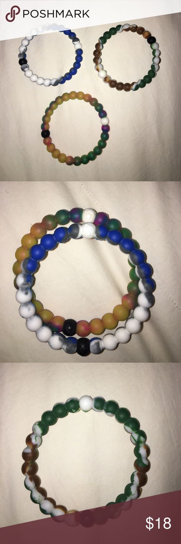 Lokai bracelets Selling the 2 bracelets listed together for $8 each because they are authentic. The army one is not which is why it is $5. The army one doesn't have the logo on it, but the other two do. Can buy all three for $13. Let me know if interest in an individual one, and I can make a separate posting. :) All three size M. Lokai Jewelry Bracelets