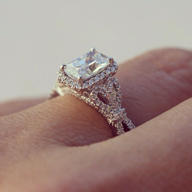 Emerald cut diamond with bow details. Artful, romantic, vintage and beautiful engagement ring.