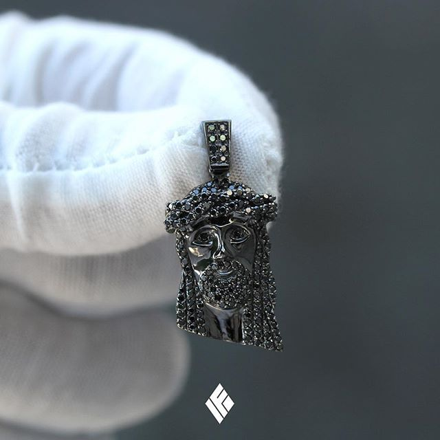Solid 14K Black Gold Micro Jesus Piece Fully Iced Out With Black Diamonds. Available now on www.IFANDCO.com  #JesusPiece #CustomJewelry #IFANDCO