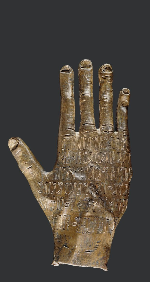 A bronze hand with inscriptions on the back...This Arabian bronze hand was made to honour a god named Ta'lab Riyam. It appears to have been cast from life since it has unusual spoon-shaped nails and a broken little finger.