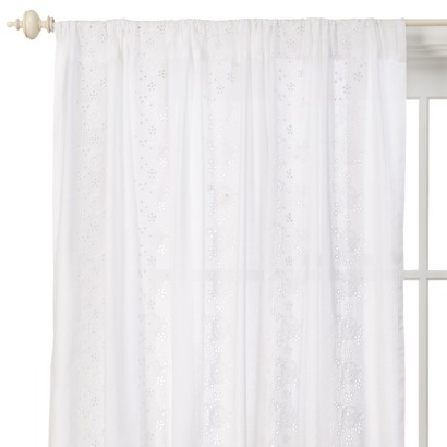 white eyelet curtains for the french door and the window.