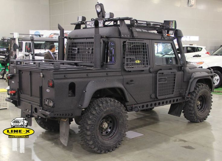 Love the drop down window cages and rockrail shackle mounts. Russian LandRover Defender by Line-X