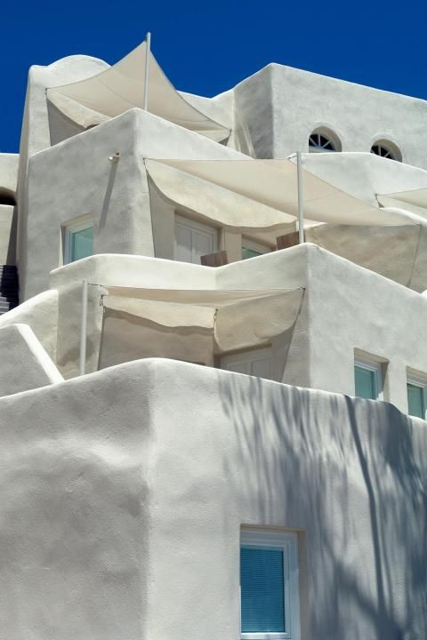 Mystique Resort, Santorini. Located on Oia's famous cliffs with dazzling views.