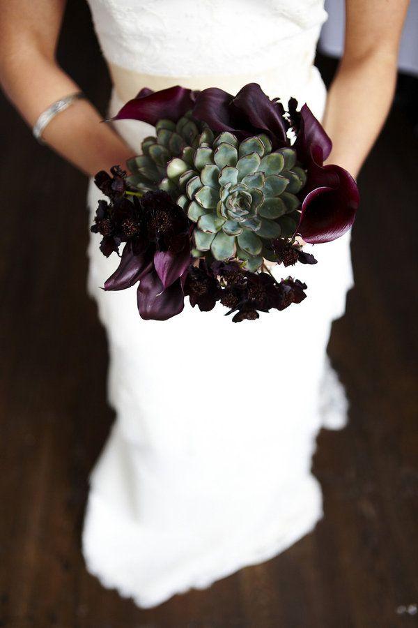 A deep purple and succulent bouquet
