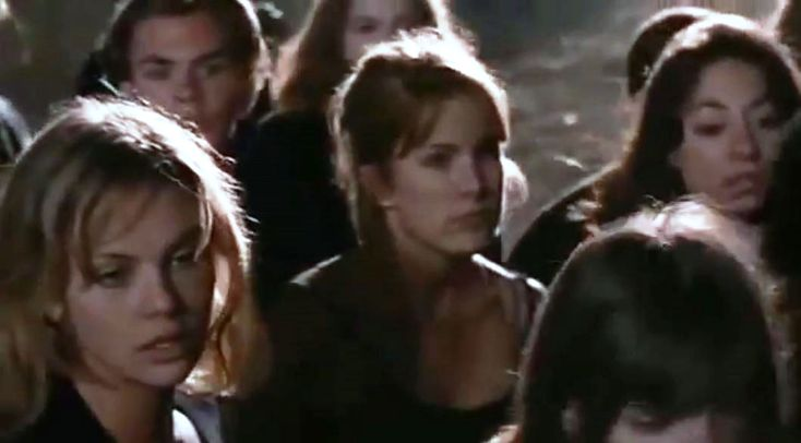 """Children of the Corn III: Urban Harvest"" DVD screen capture, 1995.  Bottom left: Charlize Theron.  This was Theron's first movie - she had a minor role as a cult follower who gets consumed by a corn stalk."