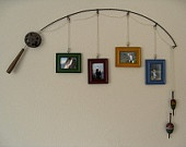 recycled fishing pole - Fishing pole made of metal wire, Fishing line is cotton cord coated and sealed, I made the reels, dobbers and pole handles from wood  Picture frames made of wood material with glass insert, Dimensions of frames are 4.25 in x 3.25 in, photo insert dimensions are 3.25 in x 2.75 in. Entire frame is sprayed with a clear seal coat - Approx 36 in long