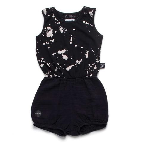 Brilliant black splash jersey cotton yoga playsuit from edgy and urban baby and children's wear brand Nununu. This cool little number has poppers to the shoulder for easy access and elasticated waist and legs. Pop it on and get stretching.