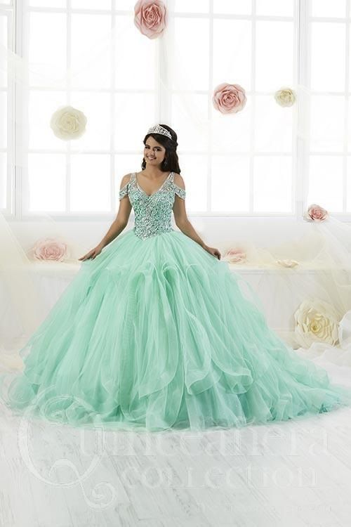 dc60ba40cf5 This art deco inspired ball gown features a jazz cold shoulder bodice pair  with a tree dimensional draped tulle skirt. The bodice is fully beaded with  ...