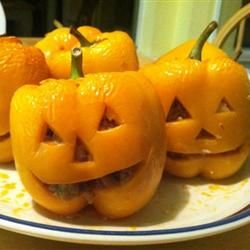 Stuffed Jack-O-Lantern Bell Peppers - cute idea, but I can pretty much promise that mine won't come out looking at all as cute as these.