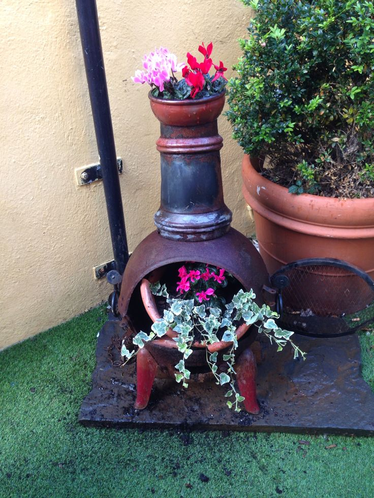 Old rusty garden chimney turned into Gorgeous garden piece