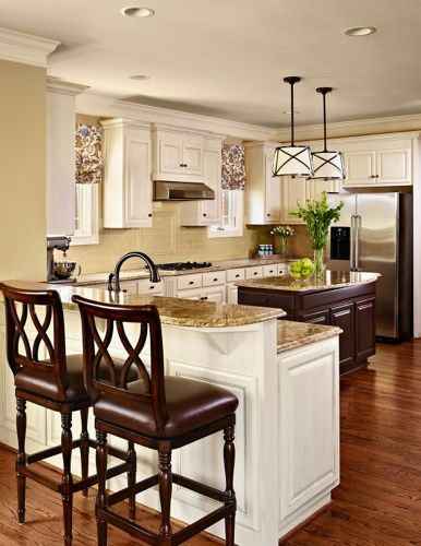 What did we change?  As I mentioned above, the existing layout remained the same — as did the appliances.  The majority of the cabinets were beautifully painted in a creamy white with a light glaze.  The island was painted in a darker wood finish.