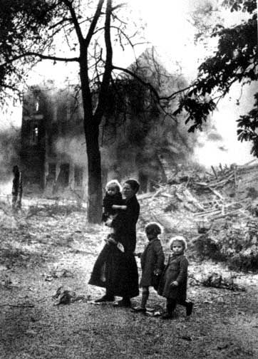 A Dutch family amidst a devastated town after the German invasion, May 1940, uncredited