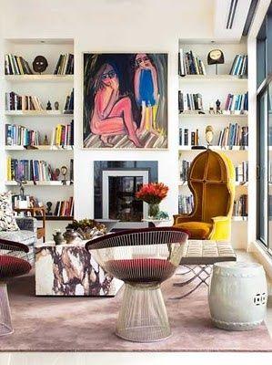 living room, mirrored shelf edges, Platner chair, garden stool, stone table, Barcelona stool, white, yellow, blue, red, pink