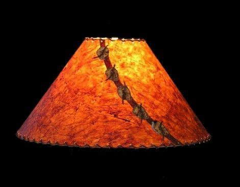 Handmade paper lampshade with antler buttons and leather lacing - just sold one of these on Rustic Artistry