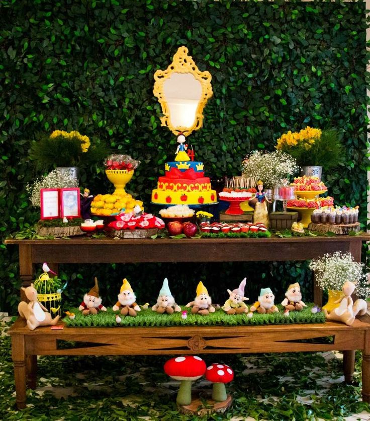Amazing dessert table at a Snow White birthday party! See more party planning ideas at CatchMyParty.com!