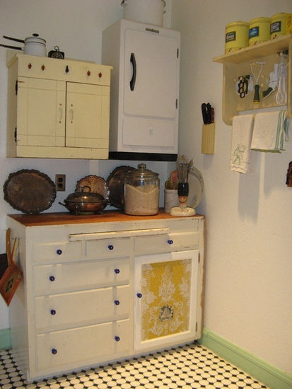 I use found vintage pieces instead of prefab cabinets in my kitchen.
