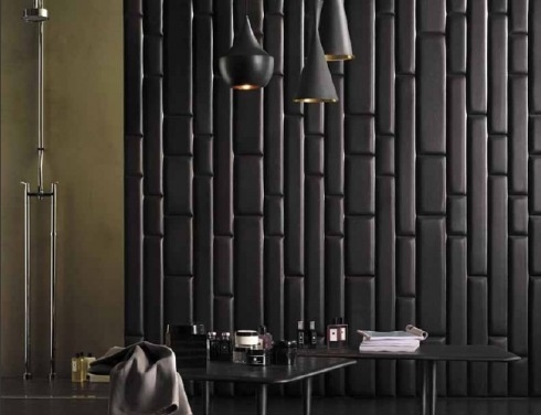 Padded leather can also be added to walls instead of wallpaper. This provides sound absorption and creates an interesting focal point.