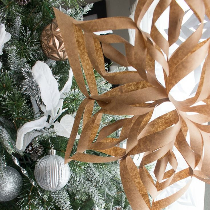 Follow these easy steps for these easy to make 3D paper snowflakes. My son taught me how to make these and I'm so impressed!