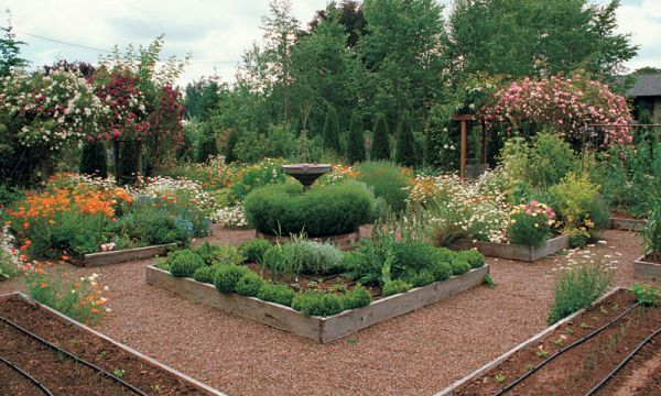 Formal design, lots of structures, and exuberant plantings  add up to a lush, generous garden.