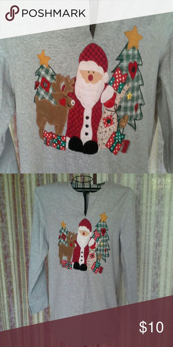 🎄Christmas sale🎄 Christmas sweatshirt For your ugly Christmas sweater needs... grey sweatshirt with Santa appliqued on front. Slit neckline and cuffs. Shows some wear but still cute at Christmas. By Bobbie Brooks. Size Large. 65% polyester, 35% cotton. Bobbie Brooks Tops Sweatshirts & Hoodies