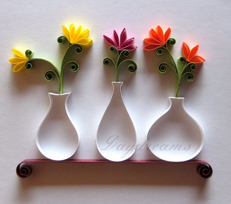 Quilled vases with flowers