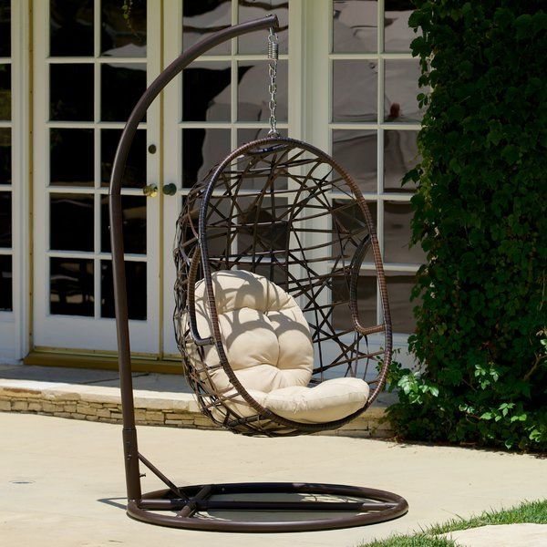 Featuring an eye-catching hanging design and abstract openwork design, this all-weather wicker and steel hammock chair lets you lounge in effortless style on the patio or by the pool.