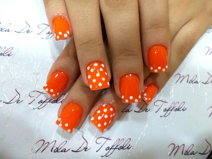 Cute polka dot nail design, I would use a different base color.
