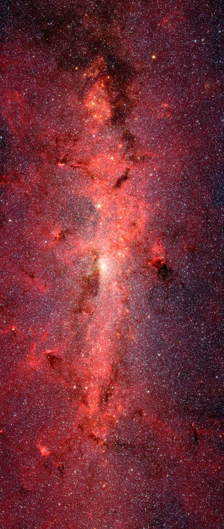 The Milky Way's Center seen in Infrared | This dazzling infrared image from NASA's Spitzer Space Telescope shows hundreds of thousands of stars crowded into the swirling core of our spiral Milky Way galaxy. In visible-light pictures, this region cannot be seen at all because dust lying between Earth and the galactic center blocks our view.