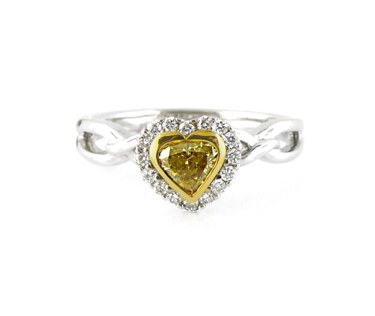 An 18ct White and Yellow Gold, Fancy Yellow Heart Shaped Diamond Halo Ring