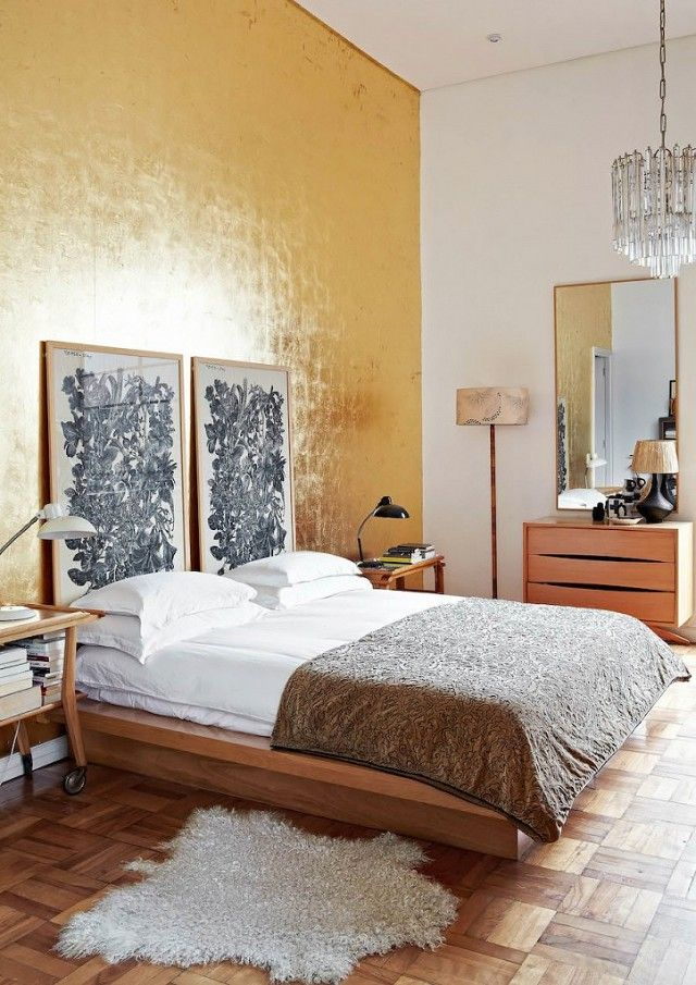 gold wall & parquet floors in the bedroom