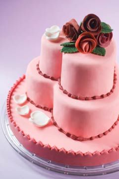 Pictures of Heart Shaped Wedding Cakes - Adorable pink fondant three tier wedding cake. The two top tiers are heart shaped and the bottom tier in round.
