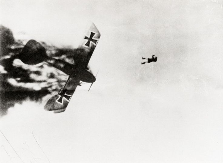 A German pilot bails out from his flaming plane during the World War I